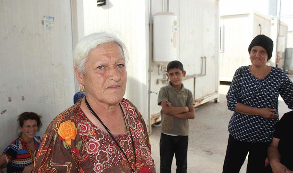Trots tre år på flykt kommer inte 59-åriga Najiba Abudi att återvända förrän Batnaya är tryggt och de får hjälp att återuppbygga sina hem.
