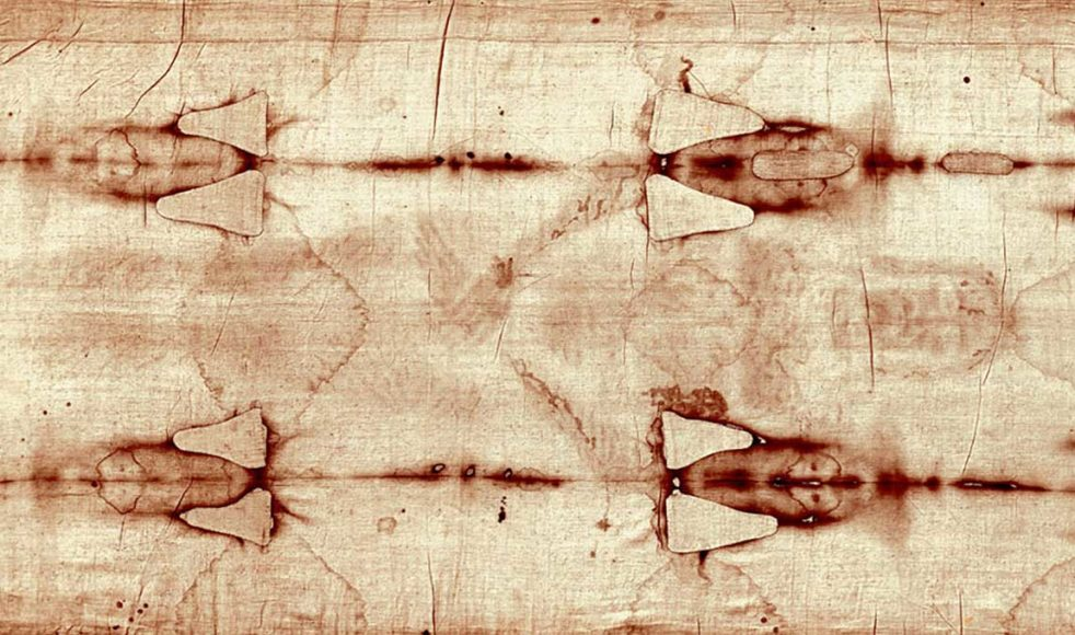 Här syns bilden så som den framträder på duken, i nästa bild som ett fotografiskt negativ. Lämningarna av blod syns i de mörka (i nästa bild ljusa) fläckarna på handleden.